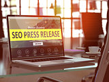 SEO Press Release Concept on Laptop Screen.