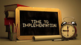 Time to Implementation Handwritten by white Chalk on a Blackboard