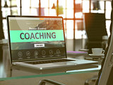 Coaching Concept on Laptop Screen.