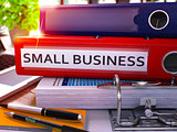 Small Business on Red Office Folder. Toned Image.