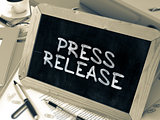 Press Release - Chalkboard with Hand Drawn Text.