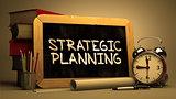 Strategic Planning - Chalkboard with Hand Drawn Text.