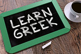 Learn Greek Handwritten by white Chalk on a Blackboard.