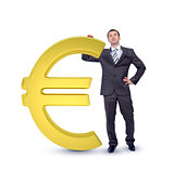 Businessman near big euro sign