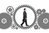 Businessman walking inside gear