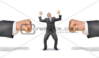 Businessman between two big fists