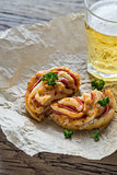 Pizza roll with glass of beer
