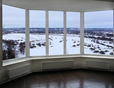 wide window of verandah with winter landscape