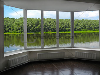 modern window of veranda overlooking the river