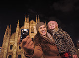 Happy mother and daughter sightseeing and taking photos in Milan