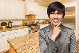 Mixed Race Woman Looking Back Over Shoulder Inside Custom Kitche