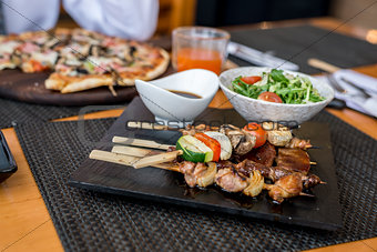 Assorted meat on skewers in  restaurant