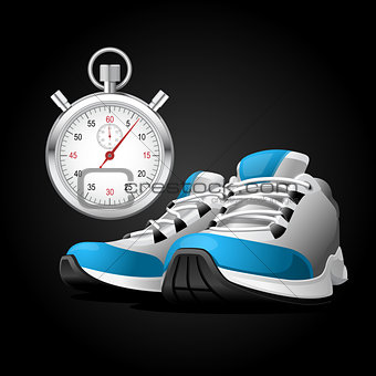 Pair of running shoes and stopwatch - healthy lifestyle