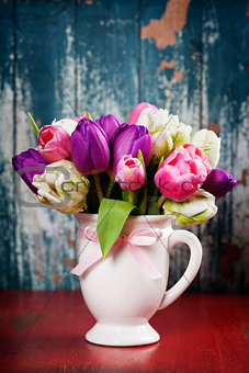 Beautiful tulips bouquet  on wooden table