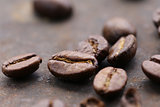 macro shot of coffee beans on a steel background, soft focus