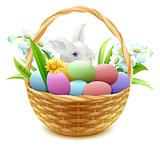 Wicker basket with Easter eggs, flowers and bunny