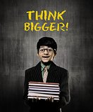 Think Big. Genius Little Boy Holding Books Wearing Glasses