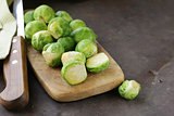 raw fresh organic brussels sprouts on cutting board