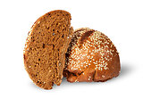 Two halves of rye bread with sesame seeds