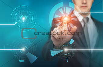 Business man touch digital icons and charts on the holographic interface. Virtual technology concept