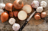 Whole and halved fresh uncooked garlic and onion