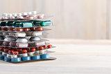 Pills and capsule pile in aluminum containers