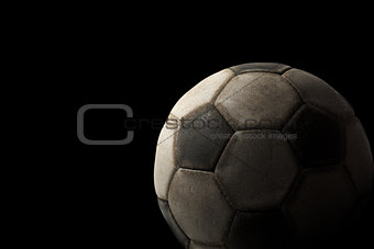 Old Soccer Ball on Black Background