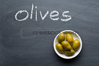 green olives on blackboard