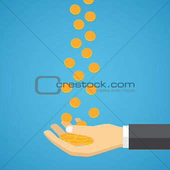 Gold coins fall into the hand.