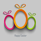 Easter card with abstract design cut out colored eggs