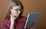 Teenage girl with tablet at home