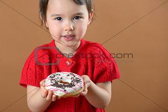 little girl holding donuts
