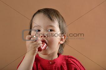 Little girl breathing asthmatic medicine  inhaler
