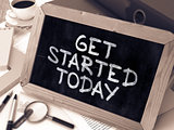 Get Started Today Handwritten by White Chalk on a Blackboard.