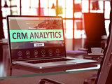 CRM Analytics Concept on Laptop Screen.