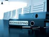 Bookkeeping on Office Folder. Toned Image.