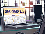 SEO Service Concept on Laptop Screen.
