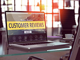 Customer Reviews Concept on Laptop Screen.
