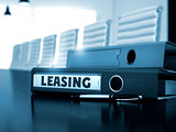 Leasing on Office Folder. Toned Image.