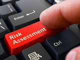Risk Assessment - Written on Red Keyboard Key.
