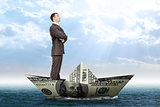 Businessman in dollar boat