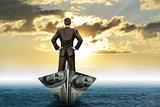 Businessman in dollar boat