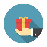 Gift box in hand flat icon