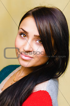 Smiling beautiful brunette woman with long hair
