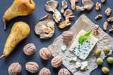 Blue cheese with walnuts, oyster mushrooms and green olives