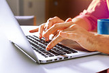 Cropped shot of a man's hands typing