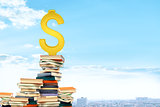 Dollar sign on pile of books