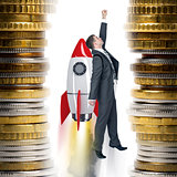 Businessman flying on rocket