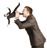 Businessman eating little man