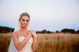 beautiful bride in a field with grass